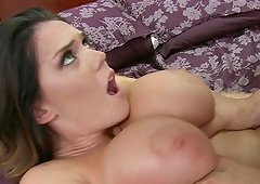 A pretty MILF with juicy boobs receives banged hard on a bed