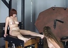 Young cheerleader dark brown loves to tie up her mistress and additionally suck her feet